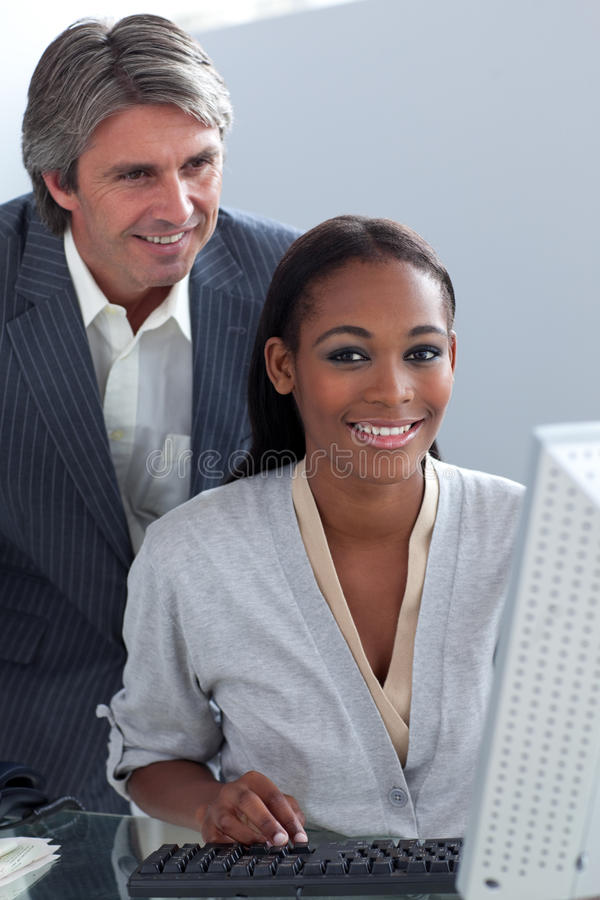 Download Mature Businessman Helping His Colleague Stock Image - Image: 12445725