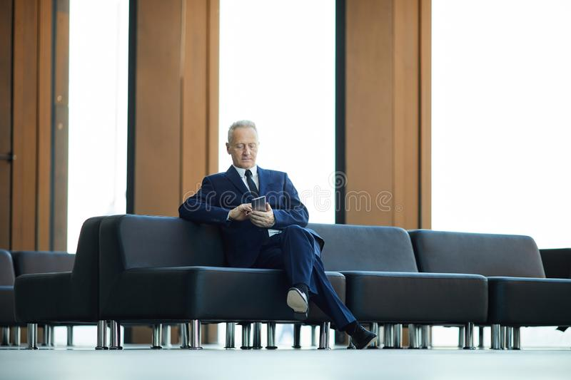 Mature Businessman in Lobby stock photography