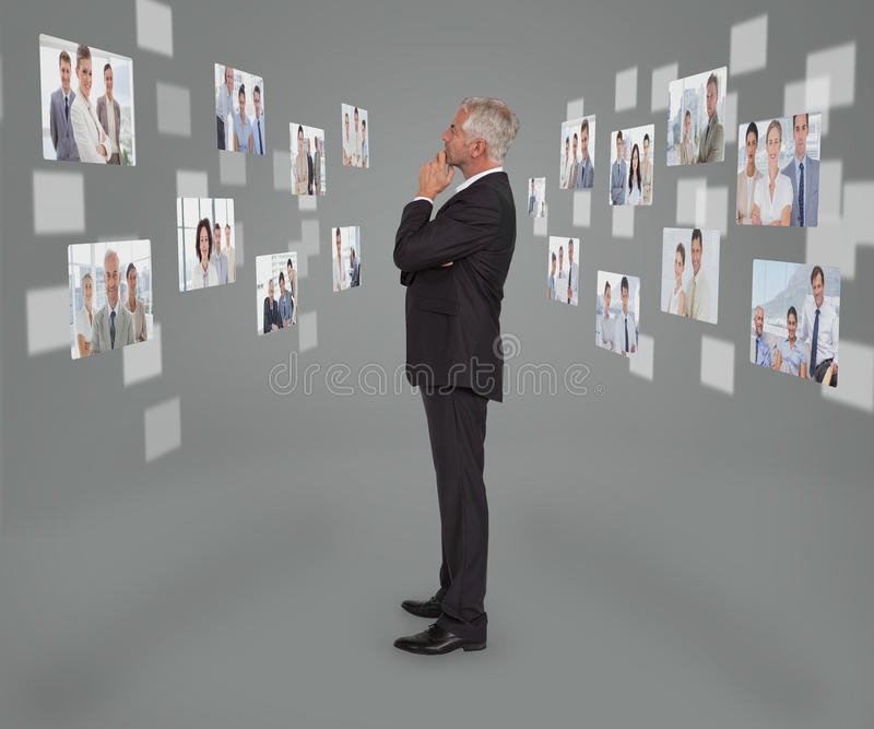 Mature businessman looking at digital interface. Showing partners royalty free stock photography