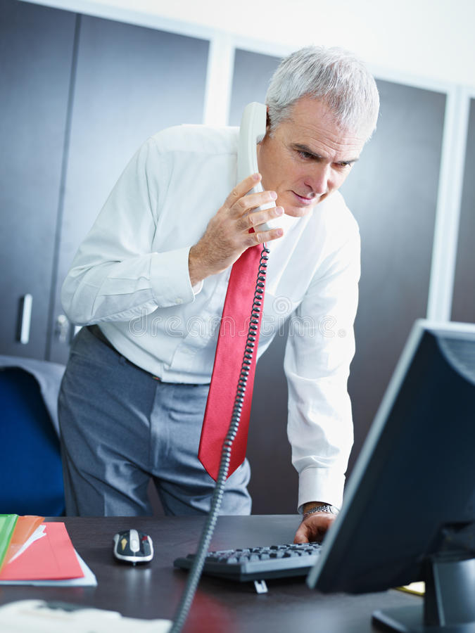 Free Mature Businessman On The Phone In Office Royalty Free Stock Images - 12760219