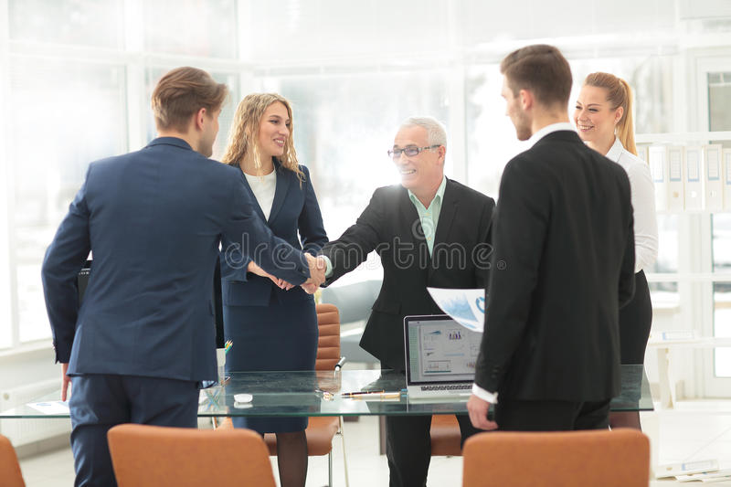 Mature businessman shaking hands to seal a deal with his partner royalty free stock images