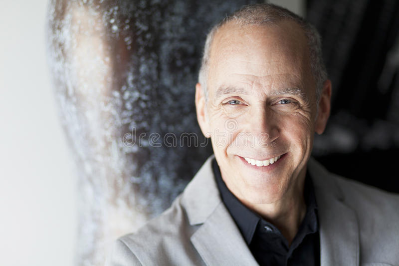 Mature Businessman Smiling At The Camera stock photography