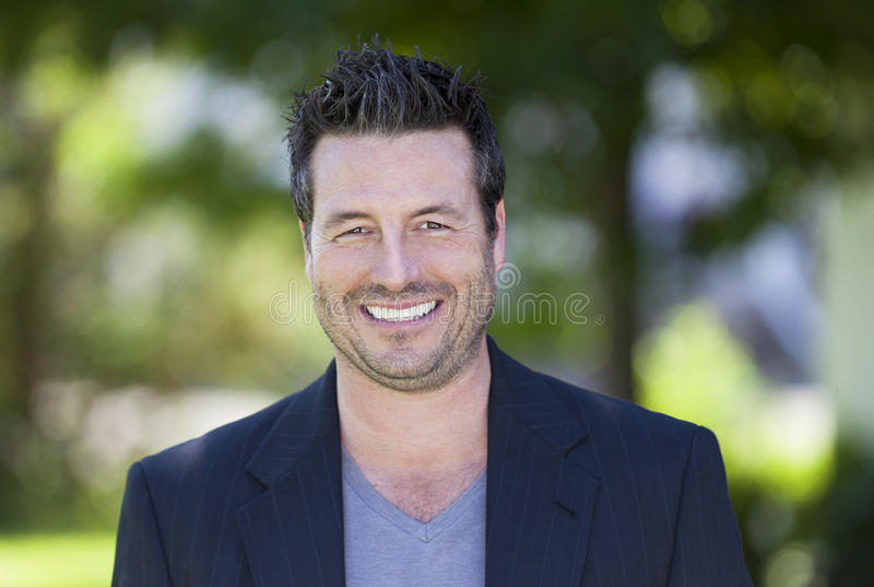 Mature Businessman Smiling At The Camera. stock photos