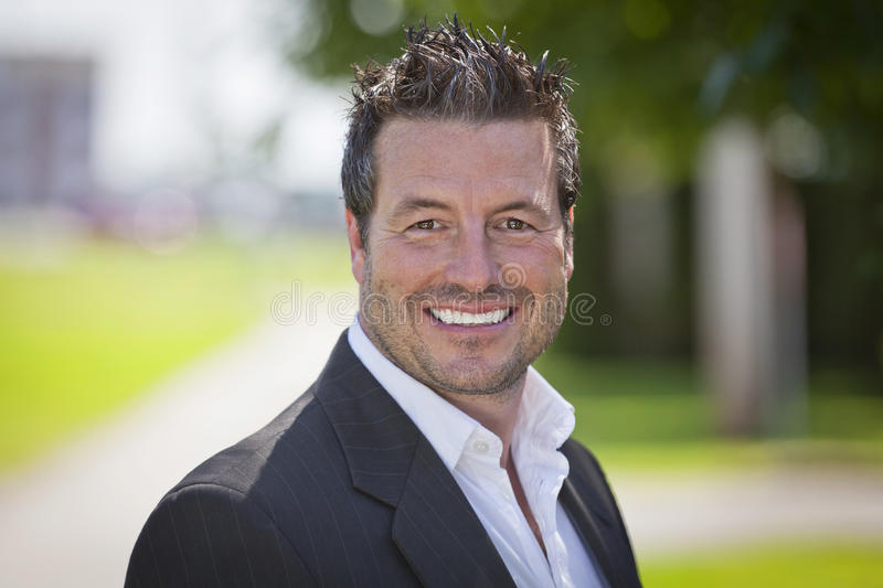 Mature Businessman Smiling At The Camera. stock photography