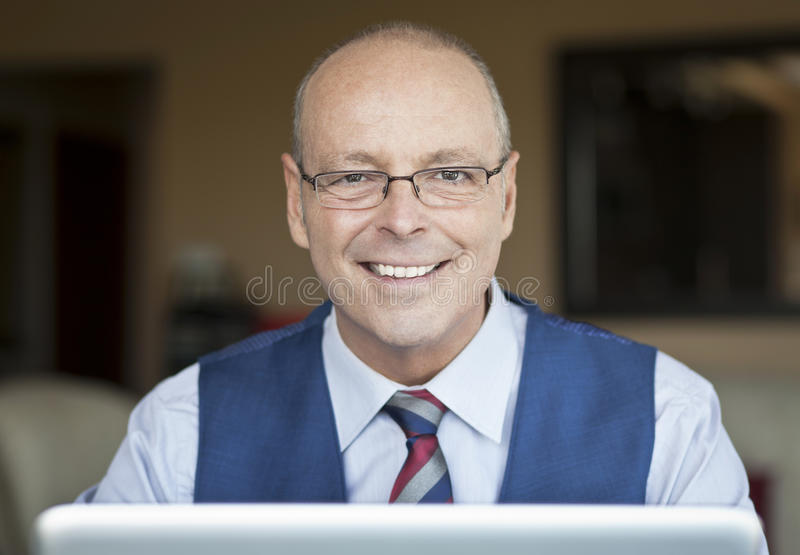 Mature Businessman Smiling At The Camera. stock photo