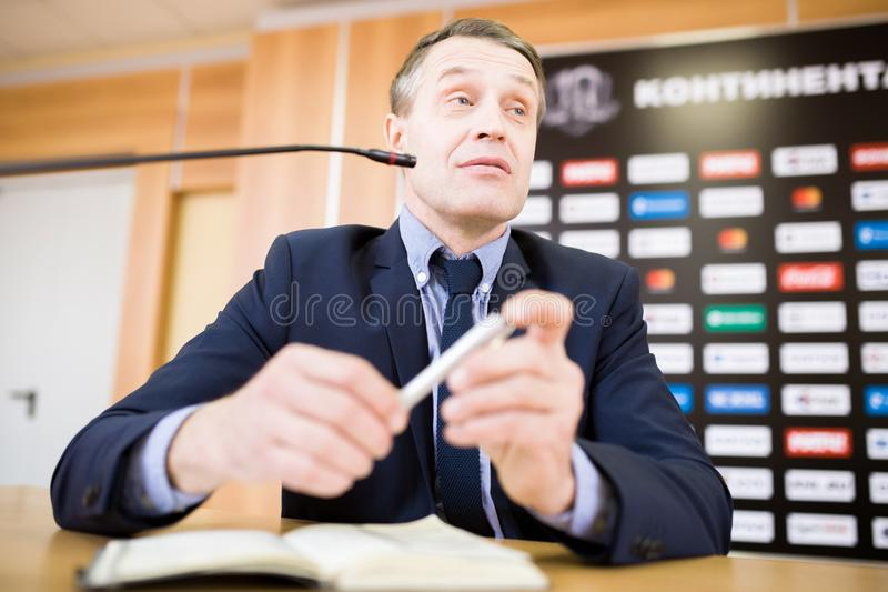 Mature Businessman Speaking at Press Conference stock photo