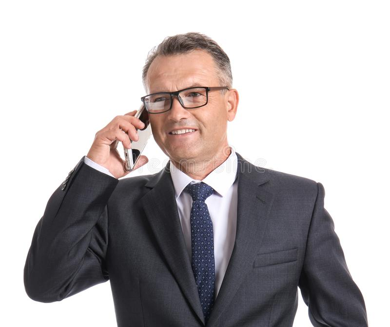 Mature businessman talking by mobile phone on white background royalty free stock photo