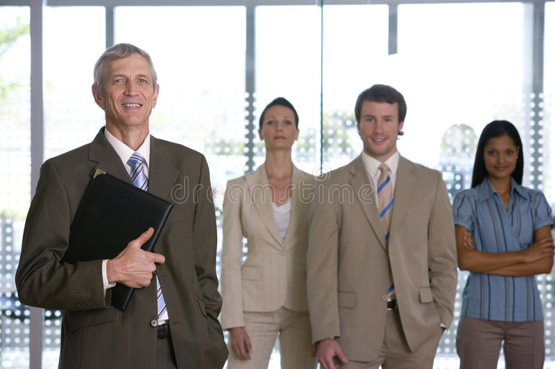 Mature businessman with team royalty free stock image