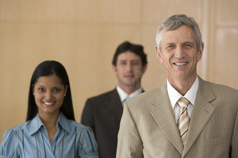 Mature businessman with team royalty free stock photos