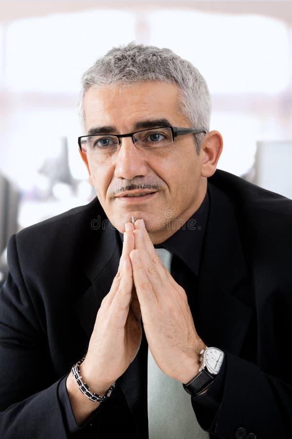Mature businessman thinking royalty free stock photo