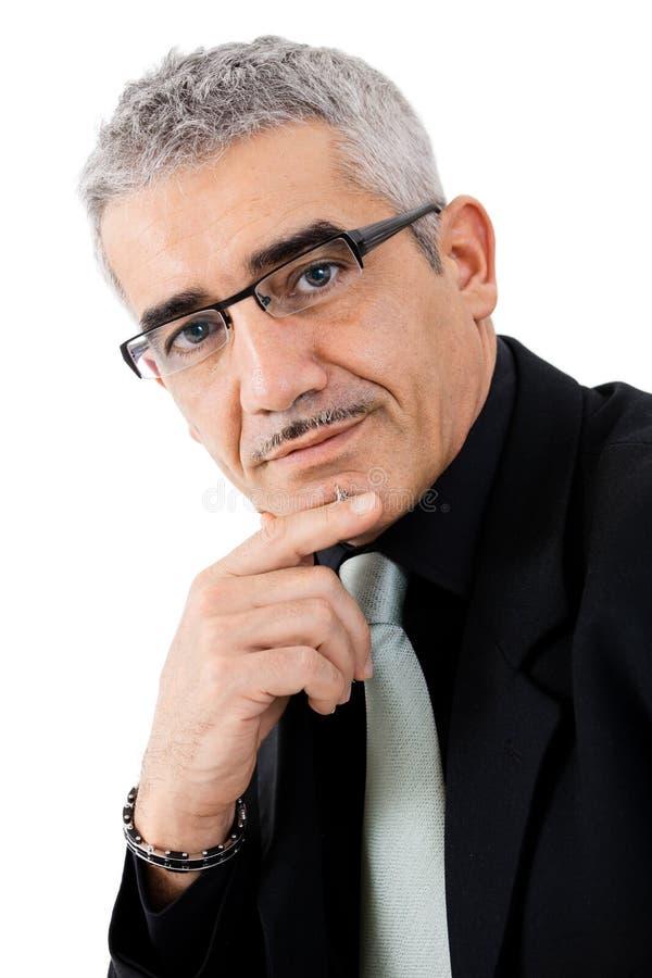 Mature businessman thinking stock photography