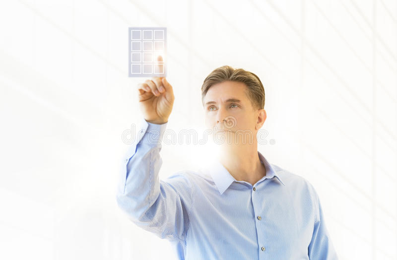 Download Mature Businessman Touching Virtual Keypad Stock Image - Image: 32060501