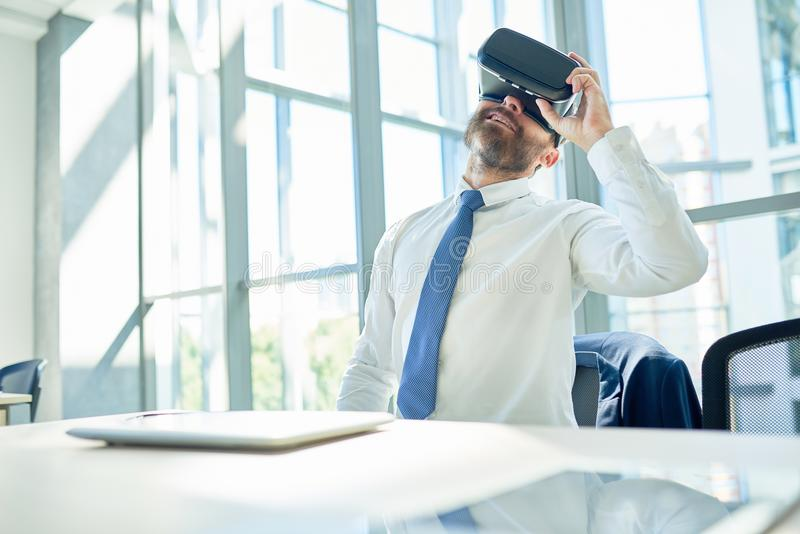 Mature Businessman Using VR Glasses in Office royalty free stock images