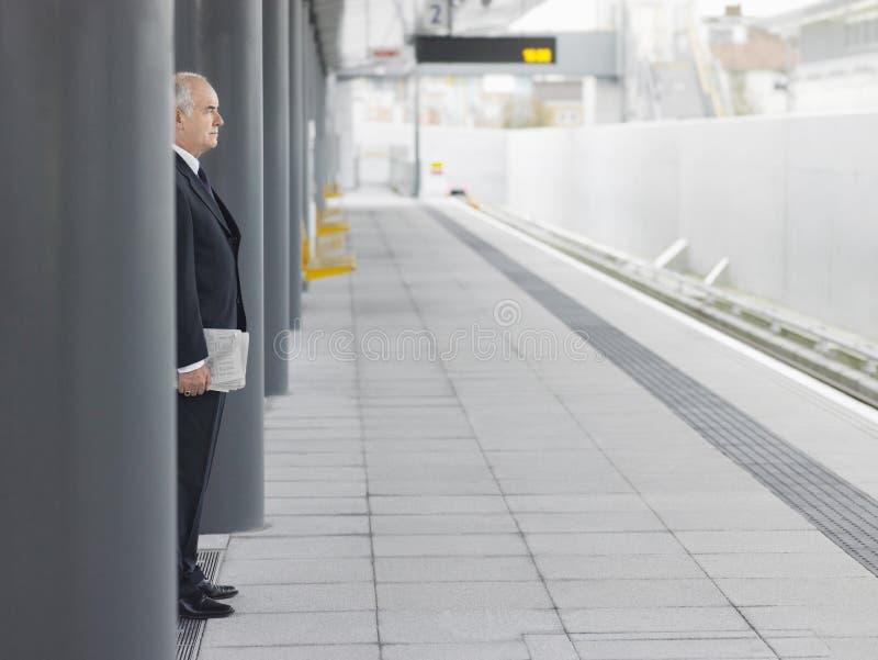 Mature Businessman Waiting At Empty Train Station stock image