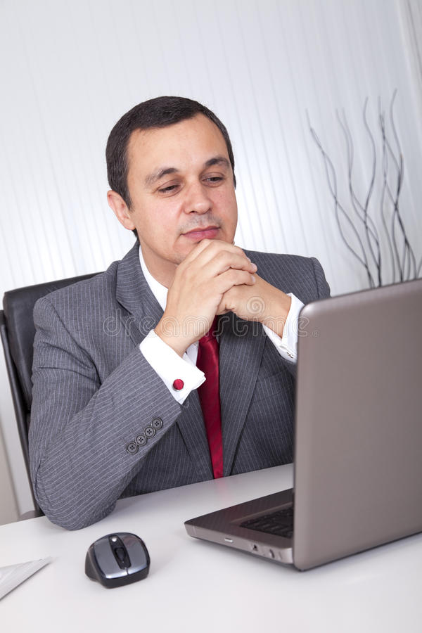 Mature businessman working stock photography