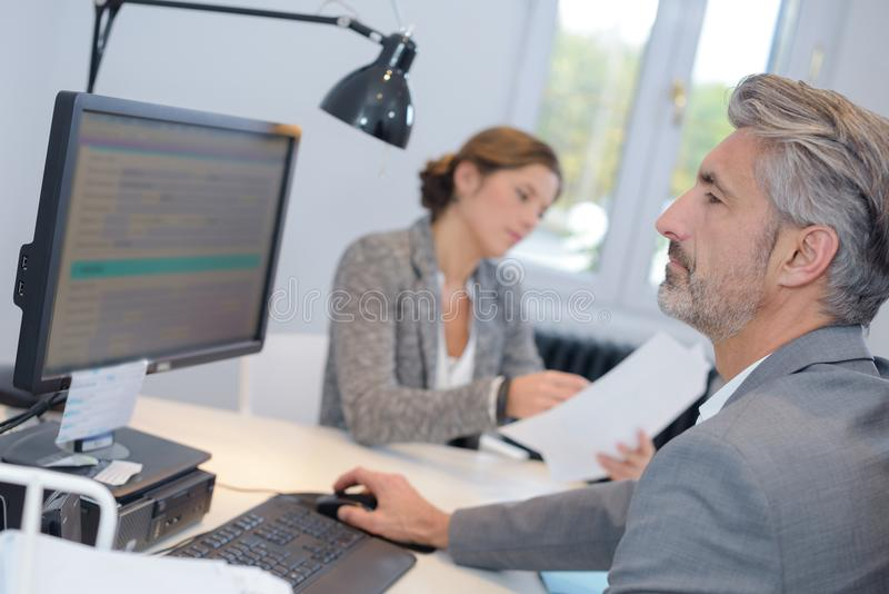 Mature businessman working on computer in office royalty free stock image