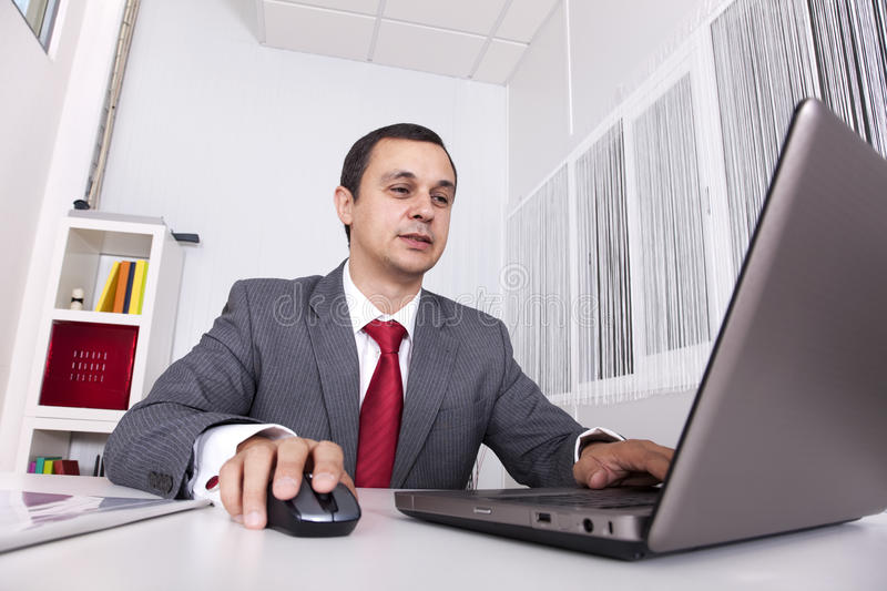 Mature Businessman Working At The Office Stock Image