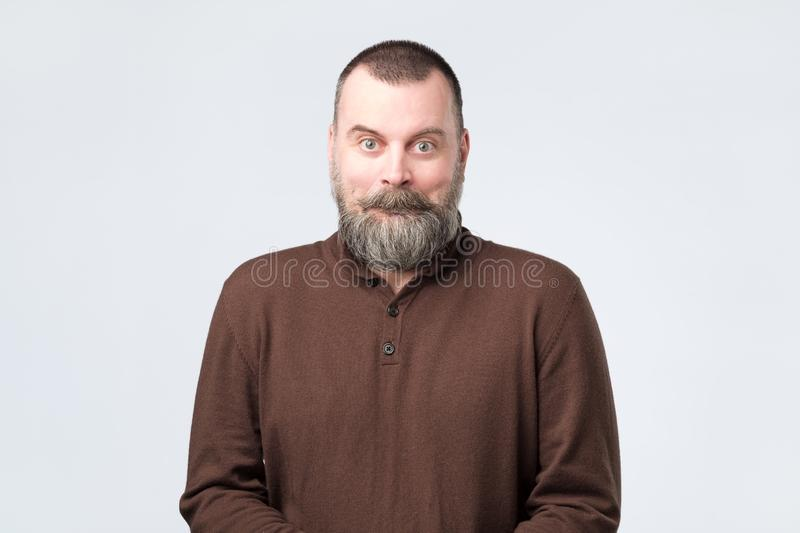 Mature man with amazed face as if he is shocked with news stock photos