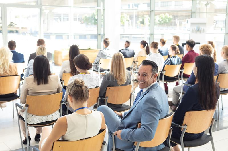 Mature Caucasian male executive sat in conference room, smiling to camera royalty free stock images