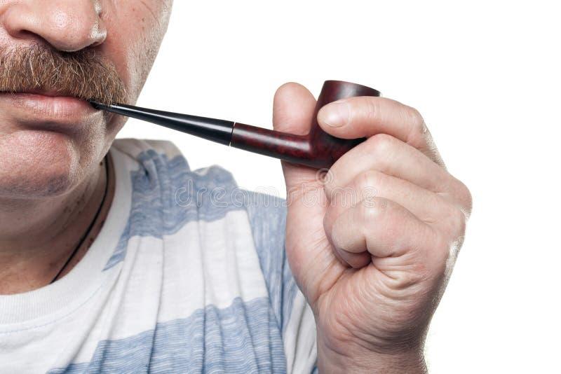 Download Mature Caucasian Man Holding Smoking Pipe In Hand Stock Image - Image: 23147307