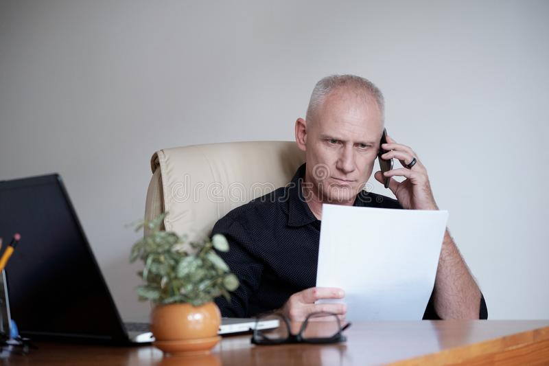 Businessman Working With Papers stock image