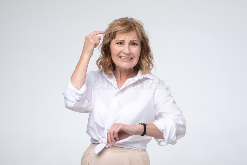 Mature caucasian woman is angry because of being late royalty free stock images