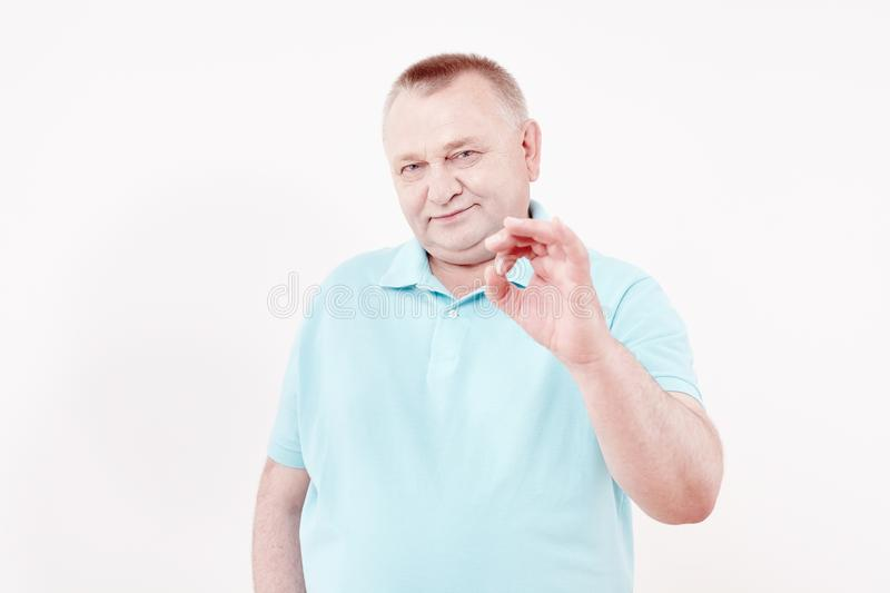 Senior showing okay sign stock photos