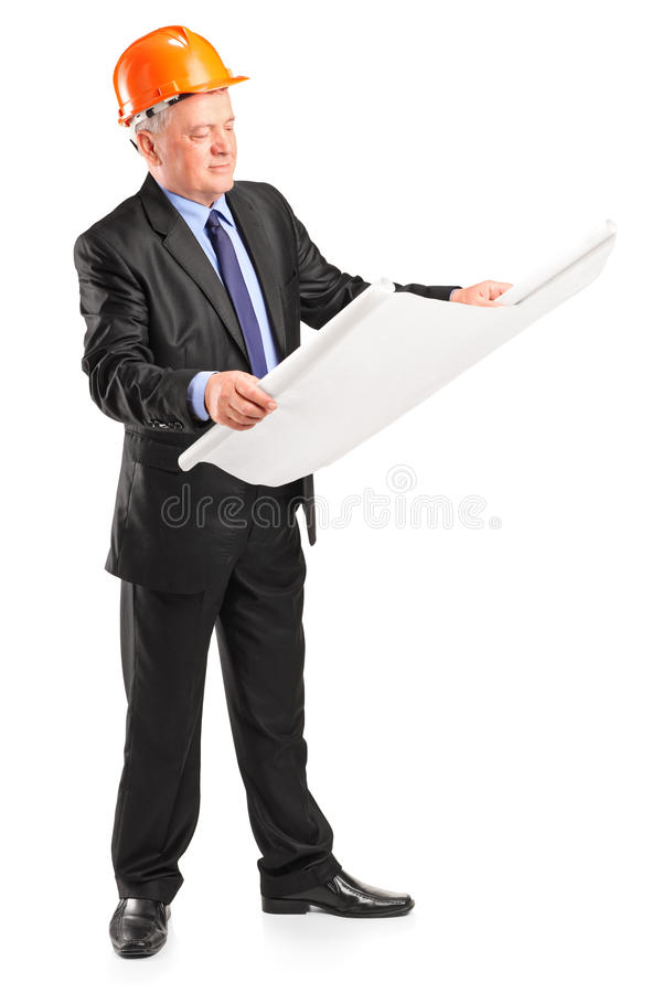 Mature construction worker holding blueprint royalty free stock images