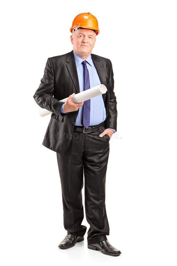 Mature construction worker holding blueprints stock photos