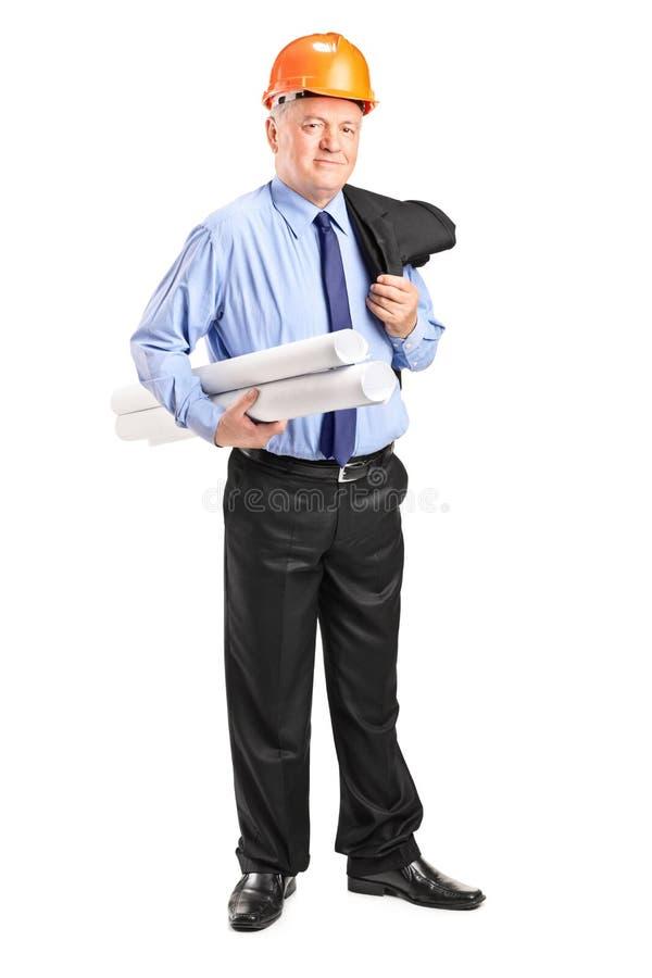 Mature construction worker holding blueprints stock photo