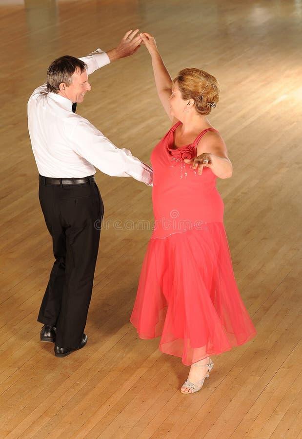 Mature couple ballroom dancing stock images