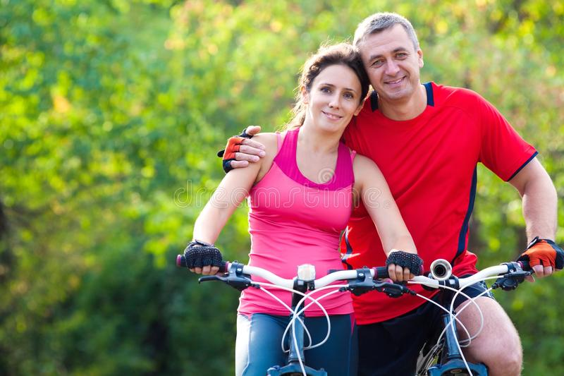 Mature couple on bicycle royalty free stock photo