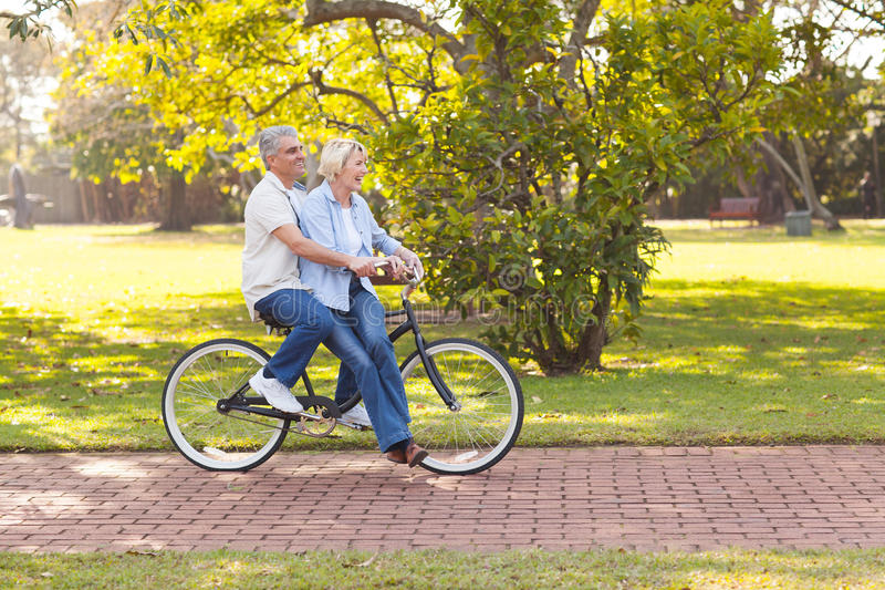 Mature couple bicycle stock image