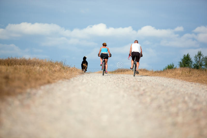 Mature couple on bike. Sport, active lifestyle stock photo