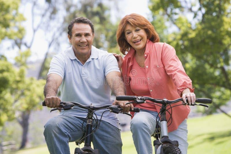 Download Mature couple bike riding. stock image. Image of latin - 5556885