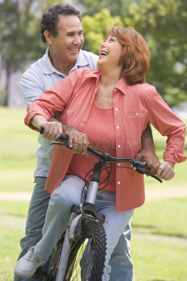Download Mature Couple Bike Riding. Stock Images - Image: 5558764