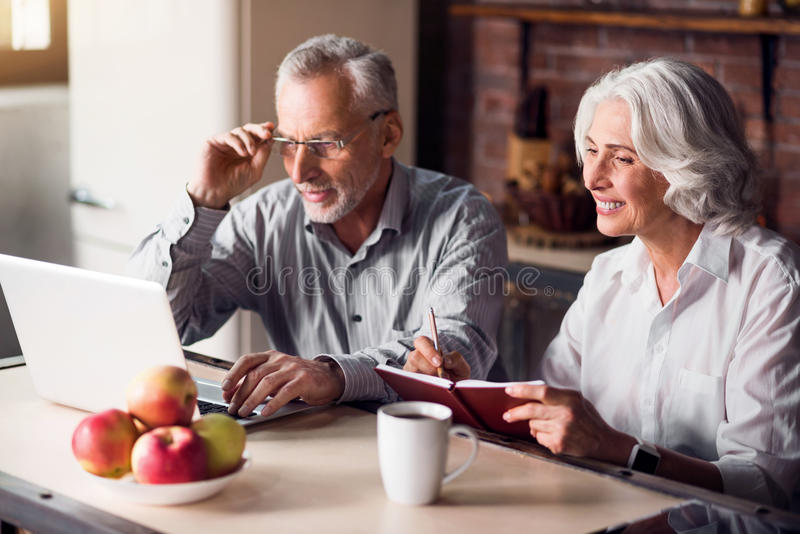 Mature couple doing internet research stock images