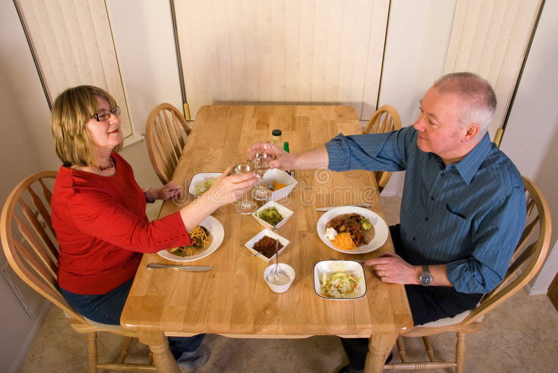 Mature couple eating dinner at royalty free stock photography