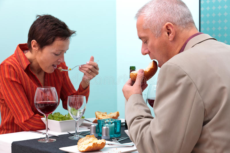 Download Mature Couple Eating Food In A Restaurant Stock Image - Image: 23096471
