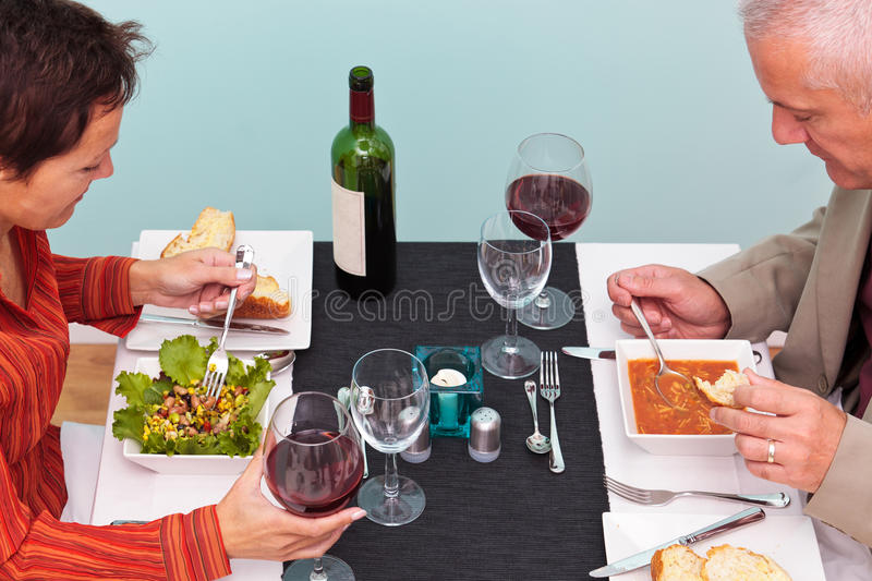 Mature Couple Eating In A Restaurant Overhead Shot Stock Photos