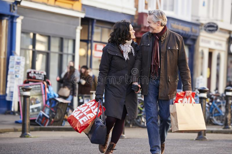 Mature Couple Enjoying Shopping In City Together stock photos