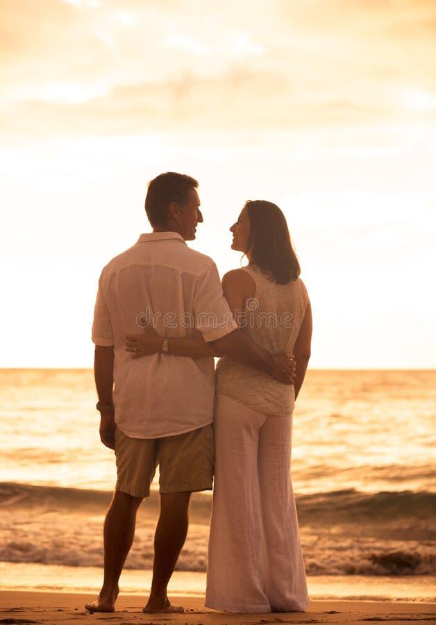 Free Mature Couple Enjoying Sunset Royalty Free Stock Photo - 44238705