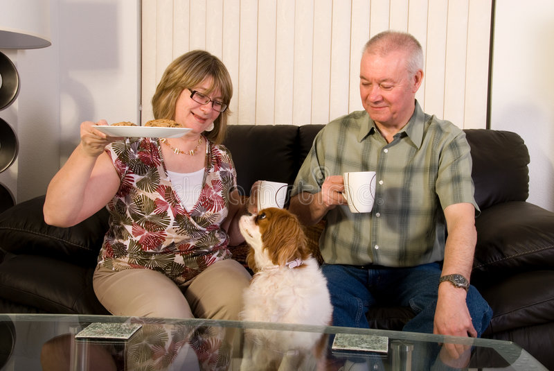 Mature couple having coffee. stock image