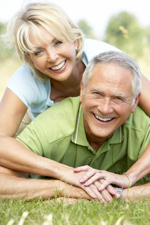 Mature Couple Having Fun In Countryside Stock Photography