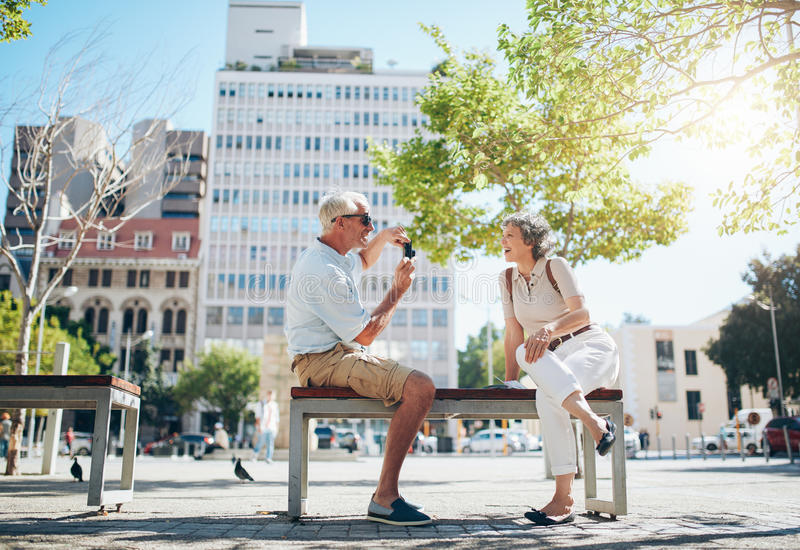 Mature couple having fun on their holiday royalty free stock photography