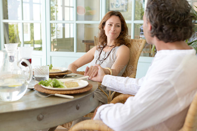 Mature Couple having lunch. stock photos