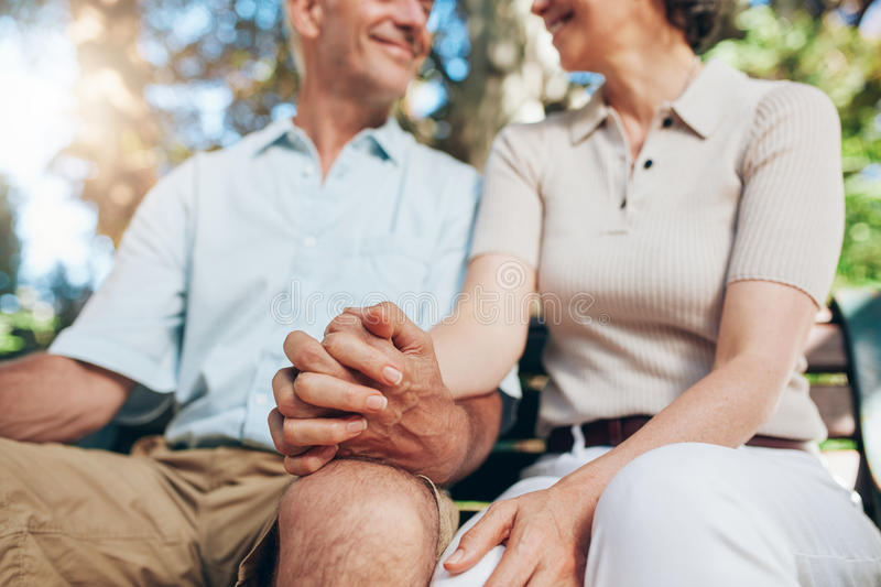 Mature couple holding hands royalty free stock photography