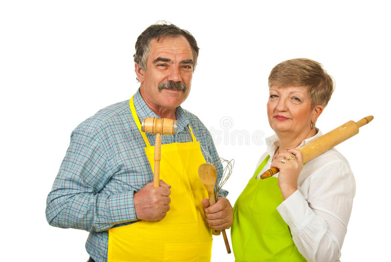 Mature couple holding kitchen utensils stock image