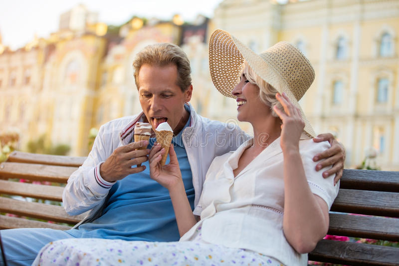 Mature couple with ice cream. royalty free stock image