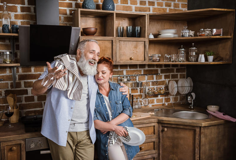 Mature couple in kitchen royalty free stock images